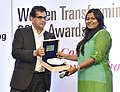 The CEO, NITI Aayog, Shri Amitabh Kant presenting the 'Women Transforming India Award 2017' to Ms. Kanika Tekriwal (Madhya Pradesh) - Air Taxies out of Jet Planes, organised by the NITI Aayog, in New Delhi on August 29, 2017.jpg