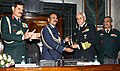 The Chief of Naval Staff, Admiral Sunil Lanba receiving the Chairman Chiefs of Staff Committee (COSC) baton from outgoing Chief of the Air Staff, Air Chief Marshal Arup Raha at a ceremony, in New Delhi.jpg