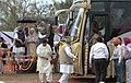 The Prime Minister, Dr. Manmohan Singh flagging off Amritsar-Nankana Sahib Bus Service in Amritsar, Punjab on March 24, 2006. The Chief Minister of Punjab Capt. Amarinder Singh is also seen (1).jpg