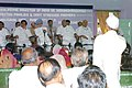 The Prime Minister, Dr. Manmohan Singh listening to a farmer in a meeting with suicide affected families and debt-stressed farmers at Dhamangoan, Amaravati in Maharashtra on June 30, 2006.jpg