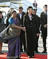The Prime Minister of Thailand, Ms. Yingluck Shinawatra being received by the Minister of State for Commerce & Industry, Dr. (Smt.) D. Purandeswari, on her arrival at the Air Force Station, Palam, in New Delhi.jpg