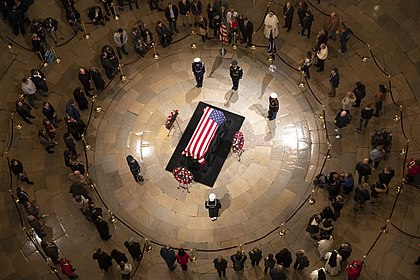 Members of the public pay their respects at the casket of George H. W. Bush lying in state in the Rotunda of the U.S. Capitol in Washington, D.C. The United States Capitol (46125518422).jpg