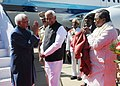 The Vice President, Shri M. Hamid Ansari being received by the Governor of Karnataka, Shri Vajubhai Vala and the Chief Minister of Karnataka, Shri Siddaramaiah, on his arrival, in Bengaluru on December 27, 2016.jpg