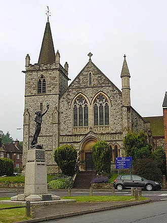 Redhill, Surrey - The War Memorial, with St Paul's United Reformed Church behind.