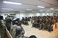 The commander of the Afghan National Army 2nd Infantry Kandak, 4th Brigade, 201st Corps, at lectern, introduces members of a Jordanian engagement team at Forward Operating Base Shinwar, Nangarhar province 130521-A-WI517-011.jpg