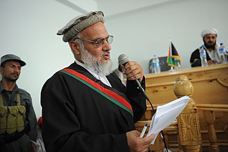 Asadabad, Afghanistan - Image: The prosecuting attorney making a statement during a public criminal trial at the courthouse in Asadabad