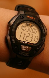 A digital watch displaying the time, seconds, and date