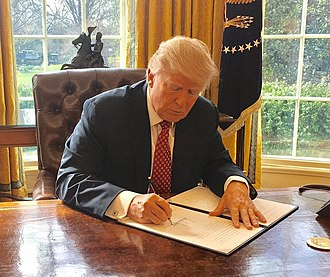 Executive Order 13780 - Image: Trump signing Executive Order 13780 (cropped)