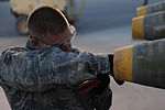 U.S. Air Force Staff Sgt. Jeremiah Smartt, a conventional maintenance crew chief with the 451st Expeditionary Maintenance Squadron Munitions Flight, positions a fuse inside a bomb at Kandahar Airfield 100823-F-OL185-681.jpg
