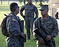 U.S. Marine Corps Pfc. Angel Colindres, right, with the 2nd Battalion, 23rd Marine Regiment, and Ecuadorian naval infantryman Cpl. 1st Class Robert Lucas speak to each other in Spanish before conducting urban 120905-M-IQ646-001.jpg