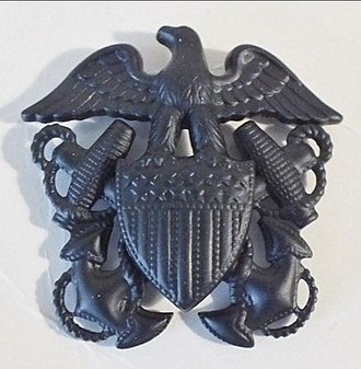 Civil Engineer Corps - Fig. 3 : U.S. Naval insignia, brass subdued per USMC regulation for officers in CBs transferred to the Corps.