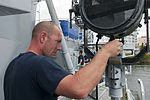 U.S. Navy Aviation Electronics Technician 1st Class Justin Kramer, selected for promotion to chief petty officer, paints a spotlight aboard the decommissioned destroyer USS Turner Joy (DD 951) in Bremerton 130828-N-MN975-008.jpg
