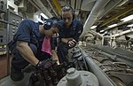 U.S. Navy Engineman 2nd Class Jeffrey Le, left, and Fireman Elizabeth Lafferty conduct maintenance June 29, 2013, aboard the amphibious dock landing ship USS Pearl Harbor (LSD 52) while underway in the Pacific 130629-N-GI544-170.jpg