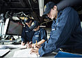 U.S. Navy Quartermaster Seaman Kyle Meadows, right, logs an entry in the pilot house aboard the guided missile destroyer USS Mustin (DDG 89) Nov. 4, 2013, in the South China Sea 131104-N-CG241-093.jpg