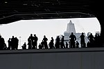 U.S. Sailors in the hangar bay of the aircraft carrier USS Harry S. Truman (CVN 75) prepare to man the rails as the ship departs Naval Station Norfolk, Va., July 22, 2013 130722-N-BD629-003.jpg