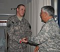 US Army 51650 Spc. Louis W. Reuter III meets Chief of Staff of the Army Gen. George W. Casey Jr.jpg