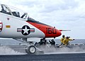 "US Navy 021211-N-0012S-001 Two Flight Deck Catapult Officers signal to launch a T-45C ""Goshawk."".jpg"