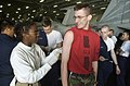 US Navy 030106-N-4142G-006 Lieutenant Erika Walker of San Diego, CA. administers Aviation Ordinanceman Second Class Darrin Anderson of Plainfield, IL. the first shot of Bacillusanthracis to help build his immune system to Anthr.jpg