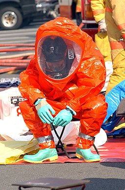 US Navy 030219-N-0252D-005 Emergency Response Team (ERT) members practice going through decontamination procedures after inspecting a space suspected to be contaminated by harmful chemical or biological agents