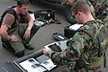 US Navy 040407-N-8937A-123 Electrician's Mate 3rd Class Michael Nisi, left, and Operation's Specialist 2nd Class David Ward examine x-ray photographs taken during an explosives training exercise.jpg
