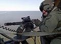 US Navy 040422-N-4374S-006 Aviation Ordnanceman 2nd Class Phillip Vaughan fires a GAU-17-A 0.30 caliber (7.62mm) Minigun.jpg