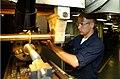 US Navy 040709-N-7232R-013 Fireman Mathew Lucas puts the final cuts on an aluminum shaft in the machine shop aboard USS John C. Stennis (CVN 74).jpg