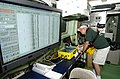 US Navy 040822-N-7676W-133 Chief Scientist, National Oceanic and Atmospheric Administration (NOAA) Mike Overfield, adjusts the display receiving data from the Towfish.jpg