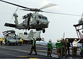 US Navy 050101-N-6817C-070 Helicopters depart USS Abraham Lincoln (CVN 72) en route to Aceh, Sumatra, Indonesia.jpg