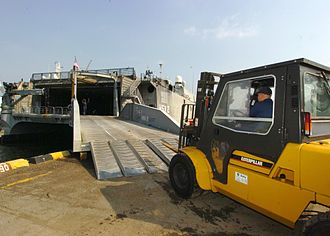 HSV-2 Swift - A forklift offloads supplies from Swift in Singapore, 30 January 2005