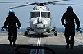 US Navy 050220-N-1444C-038 Two Royal Navy Sailors prepare to chain-down a Royal Navy Lynx Mk8 helicopter, assigned to 815 Squadron aboard the Royal Navy Type 23 frigate HMS Grafton (F80).jpg