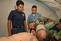 US Navy 070711-N-0989H-076 Master-at-Arms 1st Class Hector Cardona, Task Group 40.9 interpreter, demonstrates the proper procedures for providing cardio-pulmonary resuscitation to Panamanian sailors during combat medical lifesa.jpg