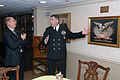 US Navy 071215-N-5248R-001 Command Master Chief Chris Engles and the Honorable Donald C. Winter, Secretary of the Navy explain the significance of a hand-stitched memento given to the Sailors of the Great White Fleet.jpg
