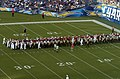 US Navy 080825-N-4420S-112 Service members march onto the field to spread the American flag across Qualcom Stadium.jpg
