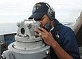 US Navy 090417-N-3666S-015 Operations Specialist 3rd Class Jesse Salgado looks through a Polaris on the bridge of the guided-missile frigate USS Reuben James (FFG 57).jpg
