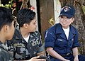 US Navy 090418-N-9520G-010 Aviation Ordanceman Airman Nai Saefong assigned to the amphibious assault ship USS Essex (LHD 2), interacts with Armed Forces of the Philipinnes military personnel during a community service project a.jpg