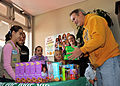US Navy 100109-N-4031K-050 Capt. Eric Gardner buys boxes of Girl Scout cookies from Girl Scouts at the commissary at Naval Air Facility Atsugi.jpg