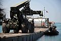US Navy 100128-N-6070S-153 ailors assigned to Amphibious Construction Battalion (ACB) 2 bring cargo into the port of Port-au-Prince, Haiti.jpg