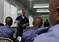 US Navy 100308-N-6676S-076 Boatswain's Mate 3rd Class Christian Sherman, from Findlay, Ohio, discusses procedures for abandoning ship with sailors from the Nigerian navy.jpg