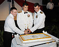 US Navy 100424-N-1906L-010 Rear Adm. Paul Bushong, Cmdr. Bruce Deshotel, and Electronics Technician 2nd Class Brandon Berry, cut the submarine community's ceremonial birthday cake at the 110th Submarine Birthday Ball.jpg