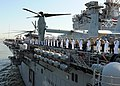 US Navy 100526-N-6676S-079 Sailors and Marines man the rails as the multi-purpose amphibious assault ship USS Iwo Jima (LHD7) passes by Staten Island en route to Fleet Week New York 2010.jpg