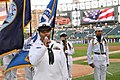 US Navy 100602-N-8848T-428 Fire Controlman 1st Class Jocelyn Elmore sings the national anthem during the 25th annual Chicago White Sox Navy Night.jpg