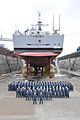 US Navy 100706-N-0000X-001 The officers and crew of the guided-missile cruiser USS Cowpens (CG 63) pose for a group photo under the ship at Fleet Activities Yokosuka's dry dock six.jpg