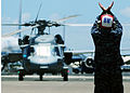 US Navy 100720-N-6854D-049 Aviation Ordnanceman Airman Mario Trejo signals the pilot of an MH-60S Sea Hawk helicopter.jpg