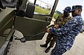 US Navy 100819-N-9643W-174 Senior Chief Master-at-Arms Charles Mobley instructs members of the Barbados Defense Force during a vehicle search drill during a Navy Criminal Investigative Service subject matter exchange for Southe.jpg