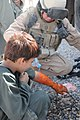 US Navy 101012-N-4345W-010 Hospital Corpsman 2nd Class Chris Lutton, assigned to Naval Mobile Construction Battalion (NMCB) 18, and a Soldier assig.jpg