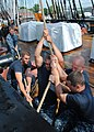 US Navy 110629-N-SH953-468 Sailors sweat the port side halyard to the main topsail yard aboard USS Constitution for the first time since the ship b.jpg