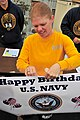 US Navy 111013-N-VN372-001 Yeoman 1st Class Jaime McIlvane helps set up for the U.S. Navy 5K run to celebrate the Navy's 236th birthday at Camp Egg.jpg