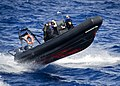 US Navy 111110-N-RI884-033 A rigid-hulled inflatable boat approaches the guided-missile destroyer USS O'Kane (DDG 77).jpg