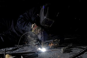 US Navy 120124-N-UT411-034 Hull Maintenance Technician 3rd Class Jesseca Crosby welds new equipment mounts.jpg