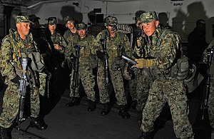 US Navy 120208-N-KB563-051 Members of the Japan Ground Self-Defense Force conduct small arms weapons training aboard the amphibious assault ship US.jpg